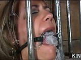 Gagged slut with big tits in bondage