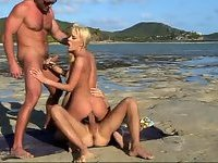 Threesome with blonde on  the beach