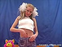 Blonde teen plays with dildo