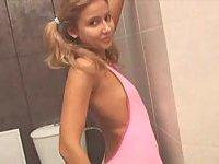 Shy teen undressing in bathroom