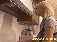Blonde Chick teasing in kitchen