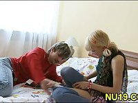 Blonde teen bends over