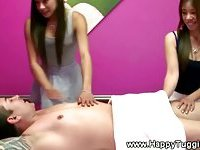 Real asian masseuses tugging the client
