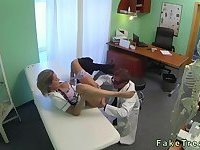 Busty blonde nurse drilling her doctor in an office