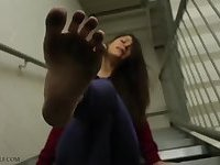 Latin Female showing her dirty feet on stairs